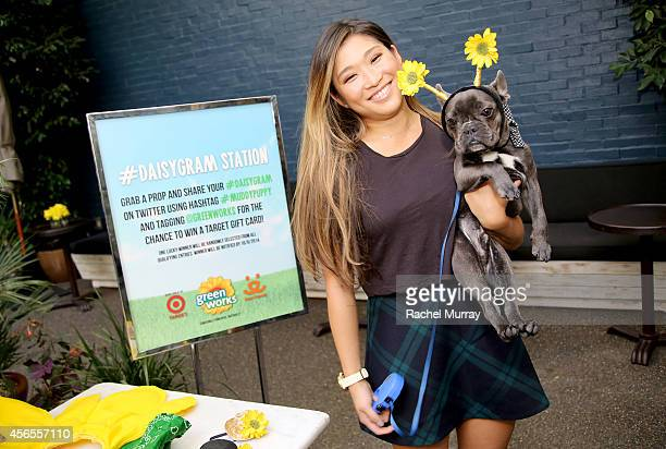 """Glee's"" Jenna Ushkowitz and her dog Bear pick props for a #Daisygram during the Green Works Muddy Puppy video premiere at the Palihouse Hotel in Los..."