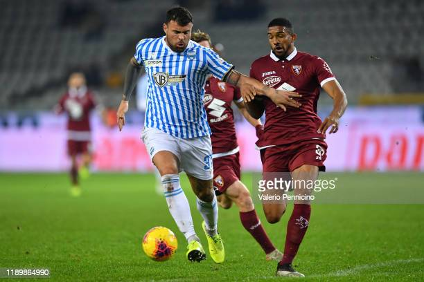 Gleison Bremer of Torino FC competes with Andrea Petagna of SPAL during the Serie A match between Torino FC and SPAL at Stadio Olimpico di Torino on...