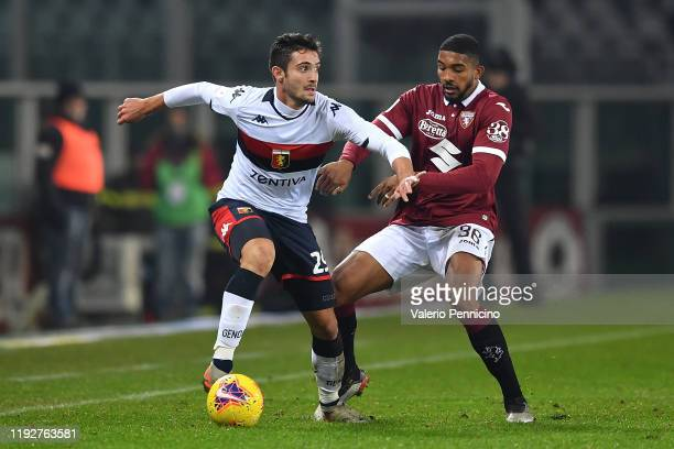 Gleison Bremer of Torino FC competes with Francesco Cassata of Genoa CFC during the Coppa Italia match between Torino FC and Genoa CFC at Stadio...