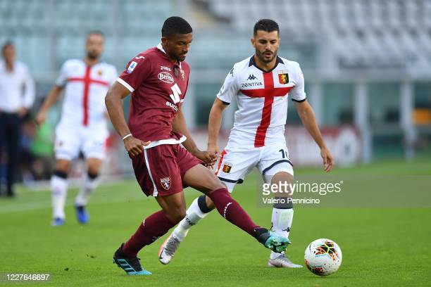 Gleison Bremer of Torino FC in action against Iago Falque of Genoa CFC during the Serie A match between Torino FC and Genoa CFC at Stadio Olimpico di...