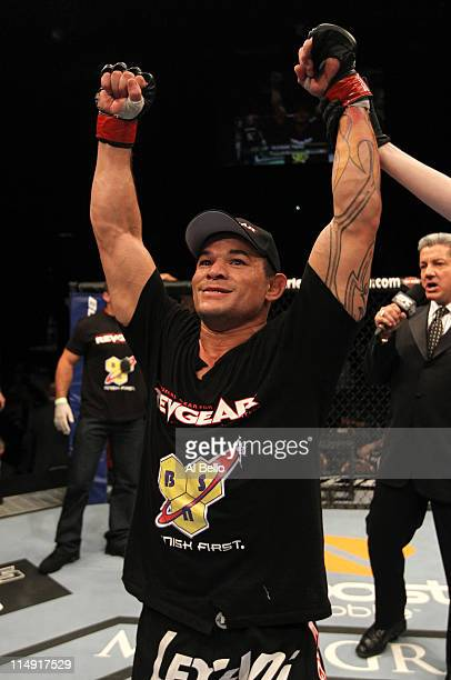 Gleison Tibau celebrates his submission victory over Rafaello Oliveira during their lightweight fight at UFC 130 at the MGM Grand Garden Arena on May...