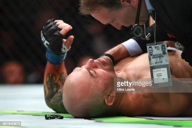 Gleison Tibau lies on the mat after being knocked out in the first round by Islam Makhachev in their Lightweight fight during UFC 220 at TD Garden on...