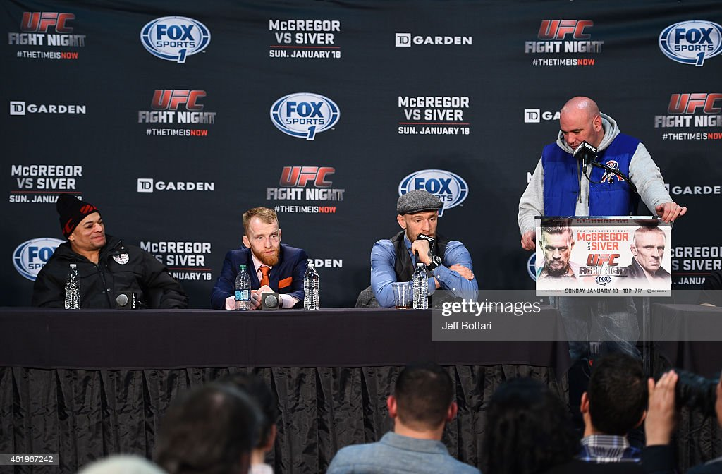 Gleison Tibau of Brazil, Paddy Holohan of Ireland sit as Conor McGregor of Ireland addresses the media with UFC President Dana White at the post fight press conference during the UFC Fight Night event at the TD Garden on January 18, 2015 in Boston, Massachusetts.