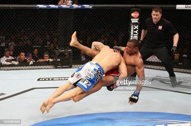 Gleison Tibau takes down Francisco Trinaldo during their lightweight fight at UFC 153 inside HSBC Arena on October 13 2012 in Rio de Janeiro Brazil