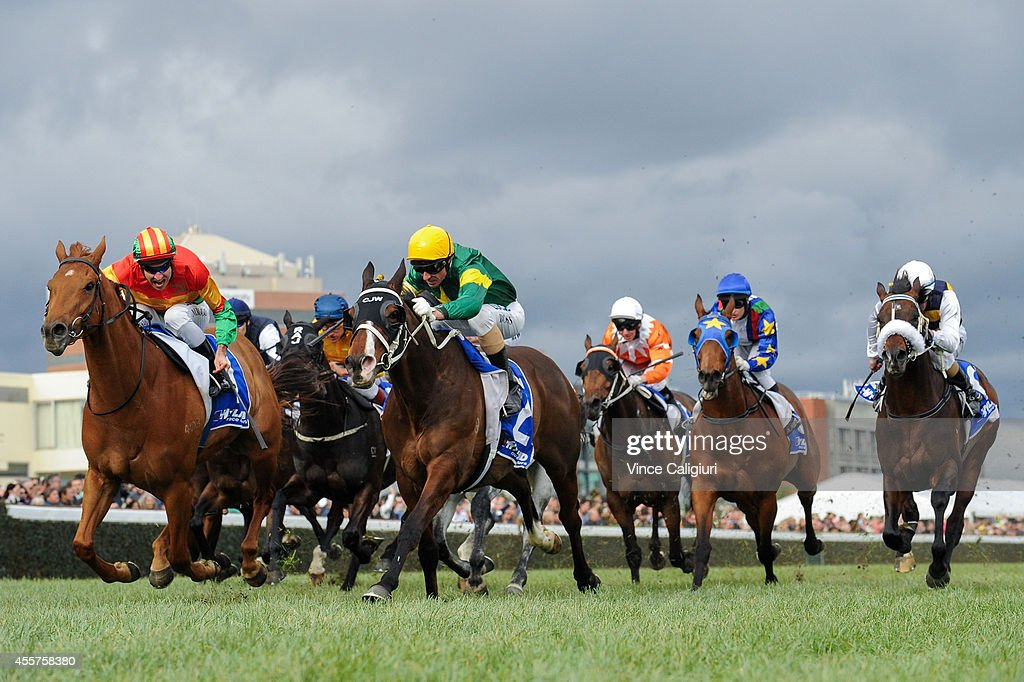 Glen Boss riding Foreteller defeats Michael Rodd riding Happy Trails (L) in Race 7, the Hyland Race Colours Underwood Stakes during the Underwood Stakes Day at Caulfield Racecourse on September 20, 2014 in Melbourne, Australia.