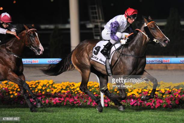Glen Boss riding London Lolly wins Race 4 the Chandler Macleod St Albans Stakes during Melbourne Racing at Moonee Valley Racecourse on March 14 2014...