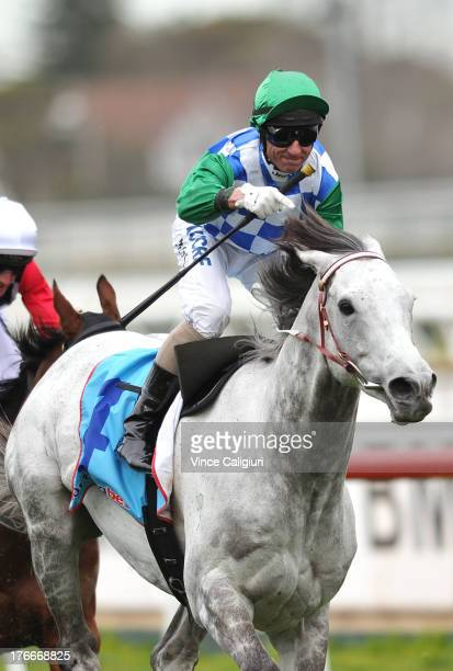 Glen Boss riding Puissance de Lune wins the PB Lawrence Stakes during Melbourne Racing at Caulfield Racecourse on August 17 2013 in Melbourne...