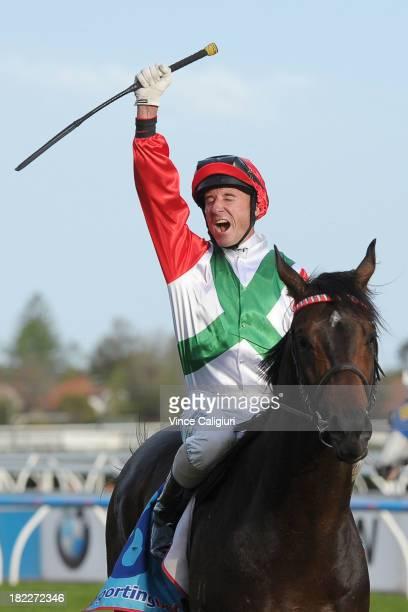 Glen Boss riding Rebel Dane reacts after winning Clamms Seafood Sir Rupert Clarke Stakes during Melbourne Racing at Caulfield Racecourse on September...