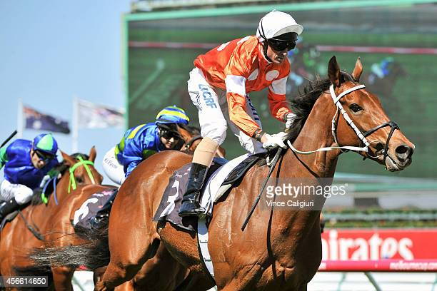 Glen Boss riding Who Shot Thebarman winning Race 3 The Bart Cummings during Turnbull Stakes Day at Flemington Racecourse on October 4 2014 in...