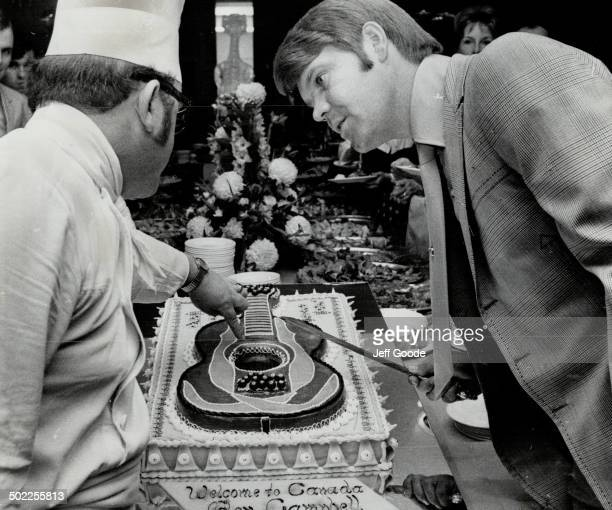 Glen Campbell and chef Donald Bannon look over cake decorated with guitar at reception before Campbell's second show at CNE yesterday The housewifes'...