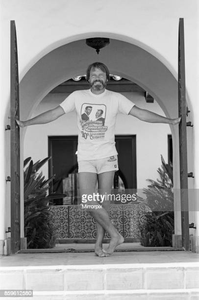 Glen Campbell at the gates of his home in Pheonix Arizona USA on a hot summer's day in July 1982 See further pictures in this set that show Glen...