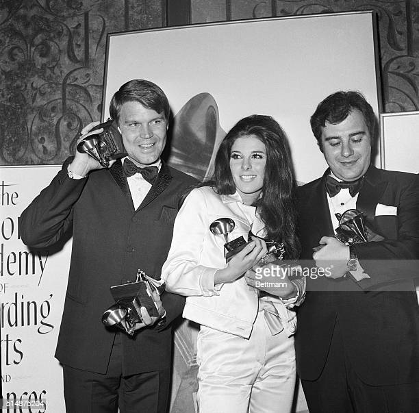 Glen Campbell Bobbie Gentry and Lala Schifrin hold the statuettes they won at the 1968 Grammy awards ceremony in Los Angeles