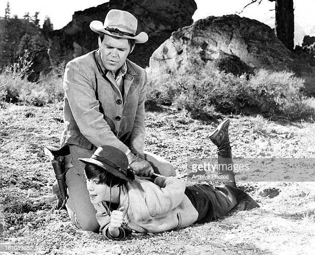 Glen Campbell contains Kim Darby in a scene from the film 'True Grit' 1969