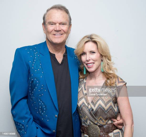 Glen Campbell poses backstage with his wife Kim following his Goodbye Tour performance at Route 66 Casino's Legends Theater on July 29 2012 in...