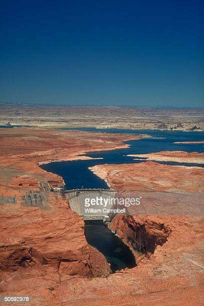 Glen Canyon Dam framed by Lake Powell re water projectsendangered Colorado River threat to states competing for water power supply