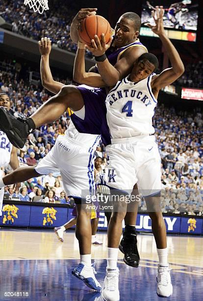 Glen Davis of LSU grabs a rebound over Rajon Rondo of Kentucky during the game on January 22, 2005 at Rupp Arena in Lexington, Kentucky. Kentucky won...