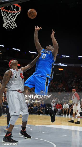 Glen Davis of Power shoots as Al Harrington of Trilogy defends in a game during Big 3Week Five at American Airlines Arena on July 20 2018 in Miami...