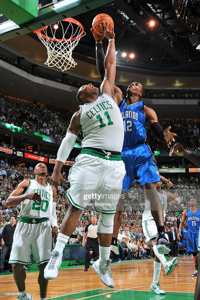 Glen Davis #11 of the Boston Celtics blocks a shot in the lane against Dwight Howard #12 of the Orlando Magic in Game Four of the Eastern Conference Finals during the 2010 NBA Playoffs at TD Garden on May 24, 2010 in Boston, Massachusetts.