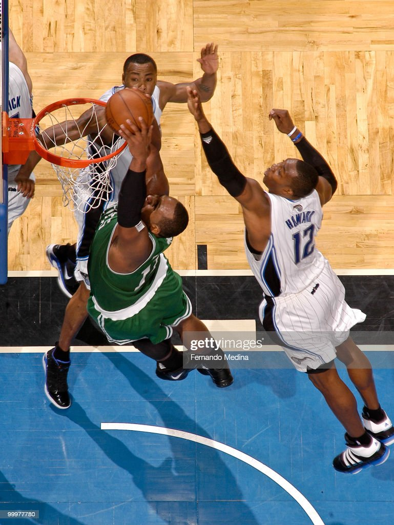 Glen Davis #11 of the Boston Celtics dunks against Dwight Howard #12 and Rashard Lewis #9 of the Orlando Magic in Game Two of the Eastern Conference Finals during the 2010 NBA Playoffs on May 18, 2010 at Amway Arena in Orlando, Florida.
