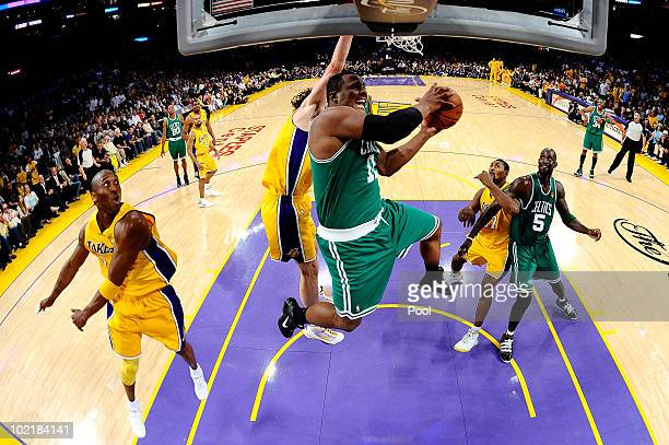 Glen Davis of the Boston Celtics goes to the basket against Kobe Bryant and Pau Gasol of the Los Angeles Lakers in Game Seven of the 2010 NBA Finals...