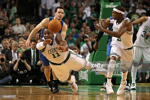 Glen Davis of the Boston Celtics passes the ball to teammate Rajon Rondo against JJ Redick of the Orlando Magic in Game Four of the Eastern...