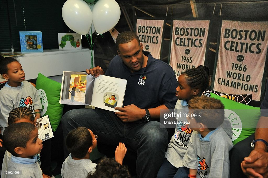Glen Davis of the Boston Celtics reads to students during the unveiling of the Learn & Play Center at the Boston Centers for Youth & Families (BCYF) Tobin Community Center on June 9, 2010 in Boston, Massachusetts.