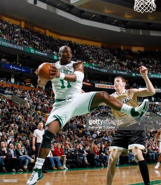 Glen Davis of the Boston Celtics rebounds against Darius Songaila of the Washington Wizards on January 14 2008 at the TD Banknorth Garden in Boston...