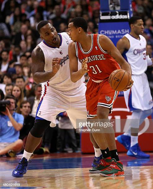Glen Davis of the Los Angeles Clippers guards John Henson of the Milwaukee Bucks at Staples Center on March 24, 2014 in Los Angeles, California. The...