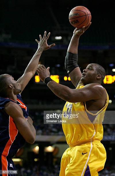 Glen Davis of the Louisiana State Tigers puts a shot up over Quinnel Brown of the Auburn Tigers during the quarterfinals of the SEC Men's Basketball...