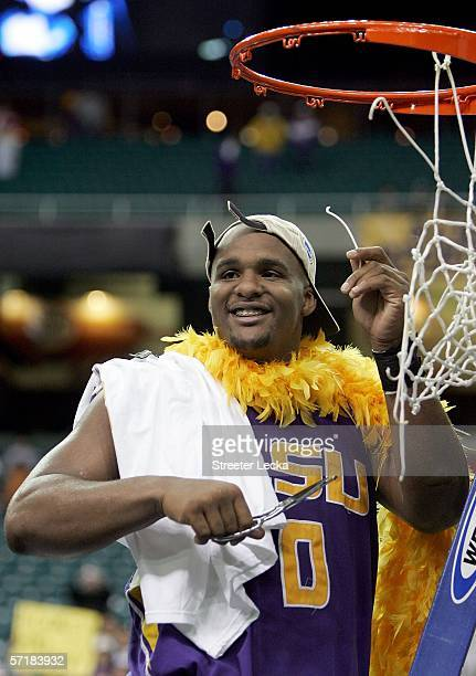Glen Davis of the LSU Tigers cuts the net after the 7060 overtime win over the Texas Longhorns during the fourth round game of the 2006 NCAA Division...