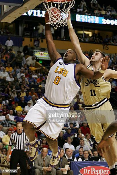Glen Davis of the LSU Tigers drives for a shot attempt against Alan Metcalfe of the Vanderbilt Commodores during day 2 of the SEC Men's Basketball...