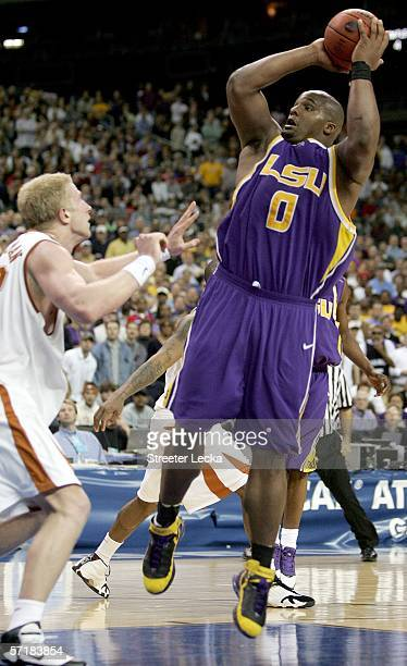 Glen Davis of the LSU Tigers shoots over the defense of Brad Buckman of the Texas Longhorns during the fourth round game of the 2006 NCAA Division I...