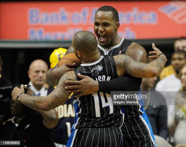 Glen Davis of the Orlando Magic celebrates a 8177 victory over the Indiana Pacers with Jameer Nelson in Game One of the Eastern Conference...