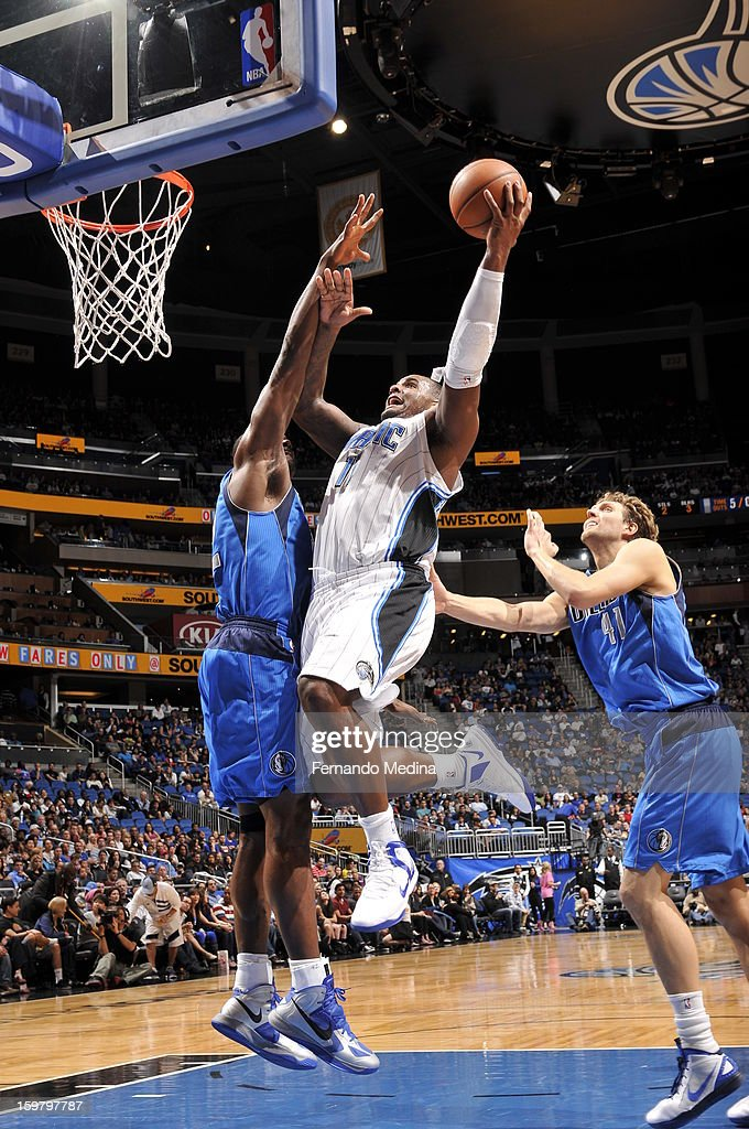 Glen Davis #11 of the Orlando Magic drives to the basket against the Dallas Mavericks on January 20, 2013 at Amway Center in Orlando, Florida.