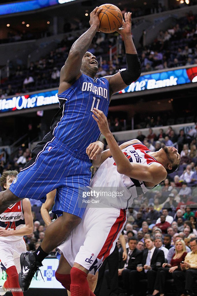 Glen Davis #11 of the Orlando Magic puts up a shot in front of JaVale McGee #34 of the Washington Wizards during the first half at the Verizon Center on February 29, 2012 in Washington, DC.