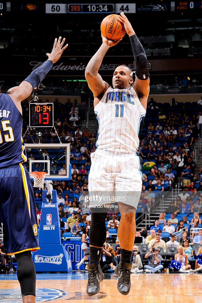 Glen Davis #11 of the Orlando Magic shoots against Roy Hibbert #55 of the Indiana Pacers in Game Four of the Eastern Conference Quarterfinals during the 2012 NBA Playoffs on May 5, 2012 at Amway Center in Orlando, Florida.