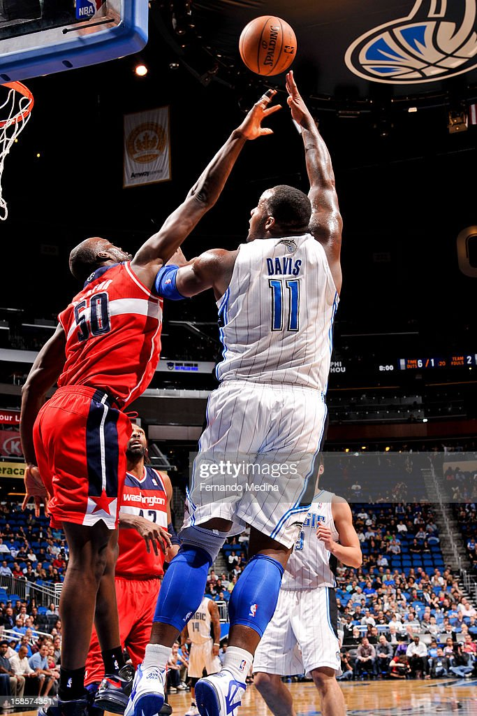 Glen Davis #11 of the Orlando Magic shoots in the lane against Emeka Okafor #50 of the Washington Wizards on December 19, 2012 at Amway Center in Orlando, Florida.