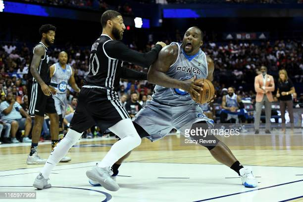 Glen Davis of the Power dribbles the ball while being guarded by Royce White of the Enemies in the first half during week seven of the BIG3 three on...