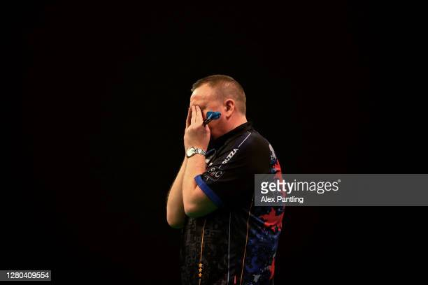 Glen Durrant of England celebrates victory after his final against Nathan Aspinall of England during the Unibet Premier League Play-Offs at Ricoh...