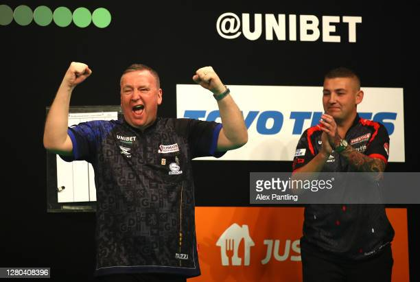 Glen Durrant of England celebrates victory next to runner up Nathan Aspinall of England following the final during the Unibet Premier League...