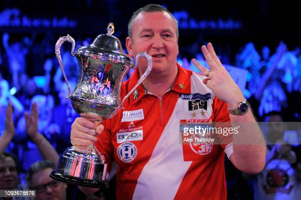 Glen Durrant of England celebrates with the BDO Lakeside Professional Men's Championship 2019 Trophy after winning the final against Scott Waites of...