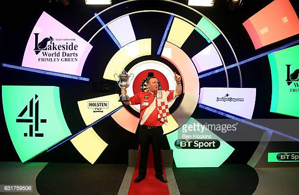 Glen Durrant of England celebrates with the trophy after defeating Danny Noppert of The Netherlands in the final of The BDO Lakeside World...