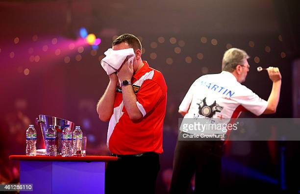 Glen Durrant of England looks dejected during his semi final match against Martin Adams of England during the BDO Lakeside World Professional Darts...