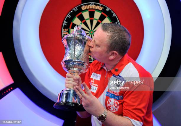 Glen Durrant of England poses with the BDO Lakeside Professional Men's Championship 2019 Trophy after winning the final against Scott Waites of...