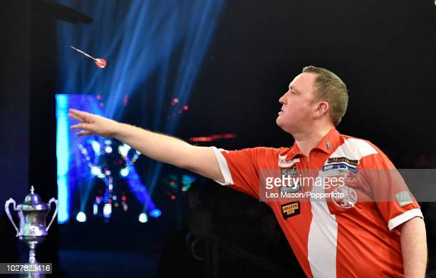 Glen Durrant of England throws during the Men's final match against Mark McGeeney of England at the BDO Lakeside World Darts Championships at The...