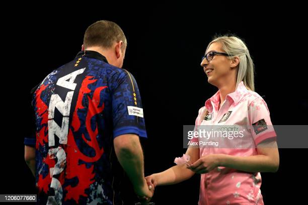 Glen Durrant shakes hands with Fallon Sherrock before their match during day two of the Unibet Premier League at Motorpoint Arena on February 13 2020...