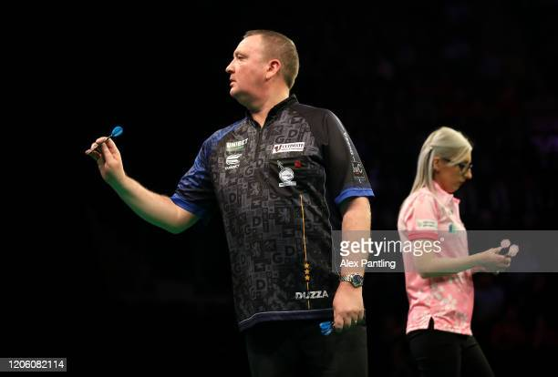 Glen Durrant throws in his match against Fallon Sherrock during day two of the Unibet Premier League at Motorpoint Arena on February 13 2020 in...