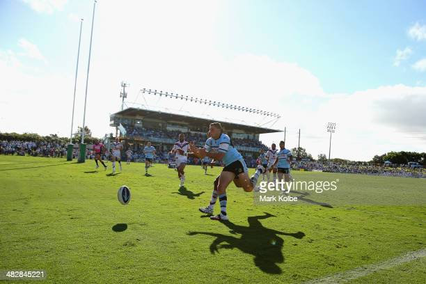 Glen Fisiiahi of the Warriors and Jonathan Wright of the Sharks compete for the ball during the round five NRL match between the Cronulla-Sutherland...