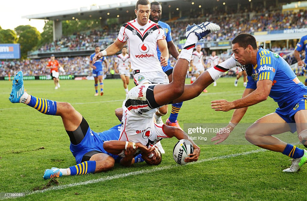 Glen Fisiiahi of the Warriors gets over the line to score a try during the round one NRL match between the Parramatta Eels and the New Zealand Warriors at Pirtek Stadium on March 9, 2014 in Sydney, Australia.