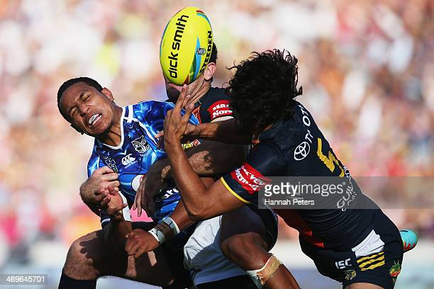 Glen Fisiiahi of the Warriors loses the ball during the semi final match between the New Zealand Warriors and the Queensland Cowboys in the Auckland...